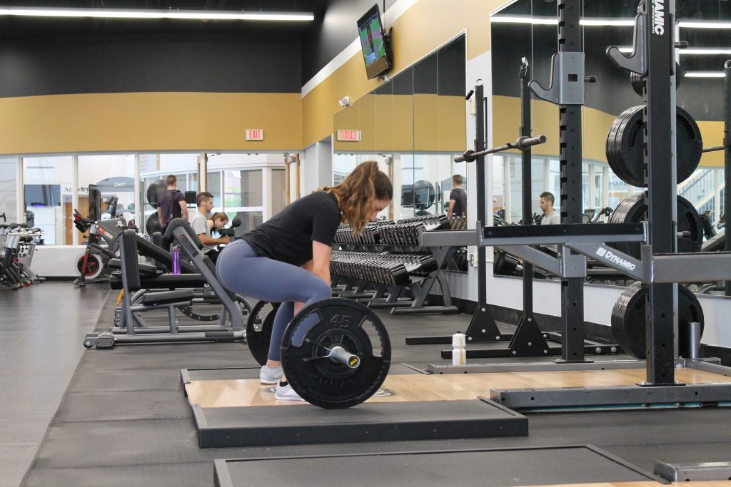 woman lifting weights or heavy equipment